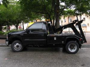 black tow truck on street